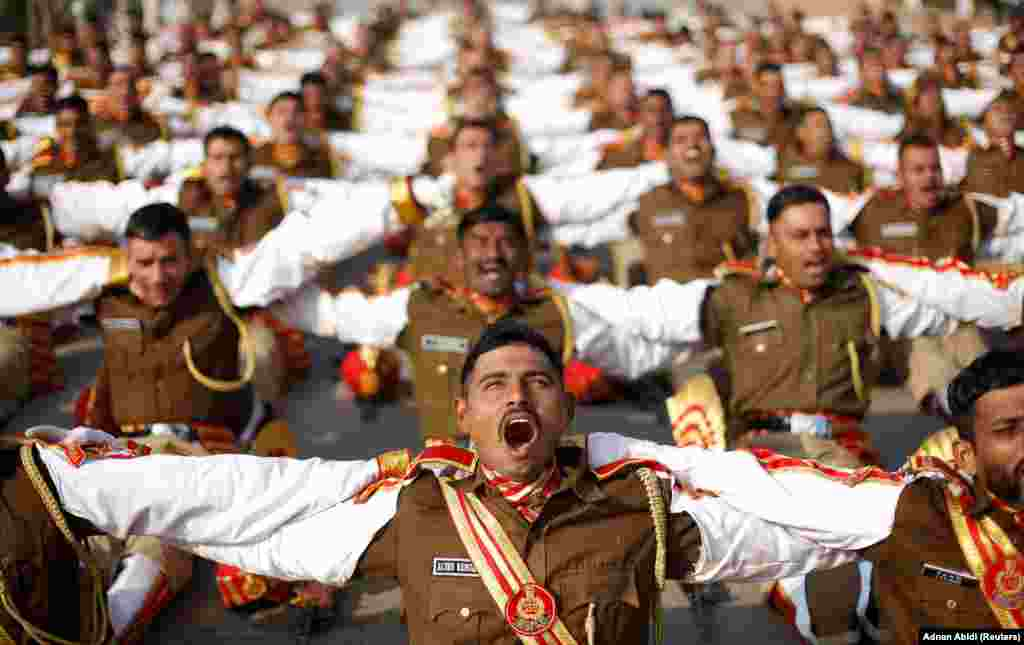Indian soldiers take part in a laughter yoga session during a rehearsal for a Republic Day parade in New Delhi. (Reuters/Adnan Abidi)