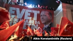 Supporters of Turkish President Recep Tayyip Erdogan celebrate at the ruling party headquarters in Istanbul on April 16.