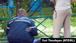 Следователи на месте убийства Юрия Буданова