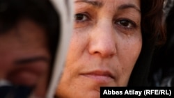 Azerbaijan -- Shiite Muslim woman mourns during a Ashura procession in Taza Pir Mosque in Baku, 2009