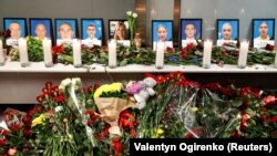 Relatives of the flight crew members of the Ukraine International Airlines Boeing 737-800 plane that crashed in Iran, mourn at a memorial at the Boryspil International airport outside Kyiv, January 8, 2020