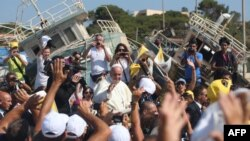 Pope Francis waves to migrants upon a visit to the Italian island of Lampedusa earlier this year.