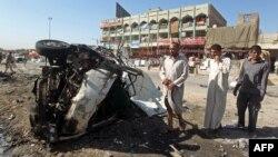 На месте взрыва в одном из районов Багдада. 29 июля 2013 года. Иллюстративное фото.