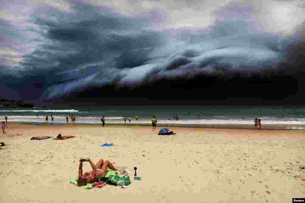 First Prize Singles in the Nature category was won by Australian Rohan Kelly for this photo of a sunbather oblivious to the ominous shelf cloud approaching her on Bondi beach. (November 6, 2015)