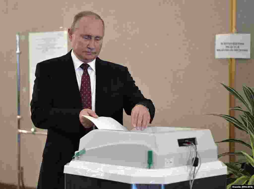 Russian President Vladimir Putin casts his vote at a polling station in Moscow.