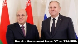 Russian Prime Minister Mikhail Mishustin (left) meets with Belarusian counterpart Syarhey Rumas in Moscow on March 11.