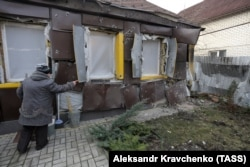 The loyalty of residents of separatist-controlled areas such as the Donetsk region town of Yasnyuvata, seen here after shelling by Ukrainian government troops in December 2017, might be tested if Ukraine's chief military prosecutor gets his way.