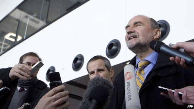 IAEA Deputy Director-General Herman Nackaerts (right) speaks to journalists before visiting Iran last month.