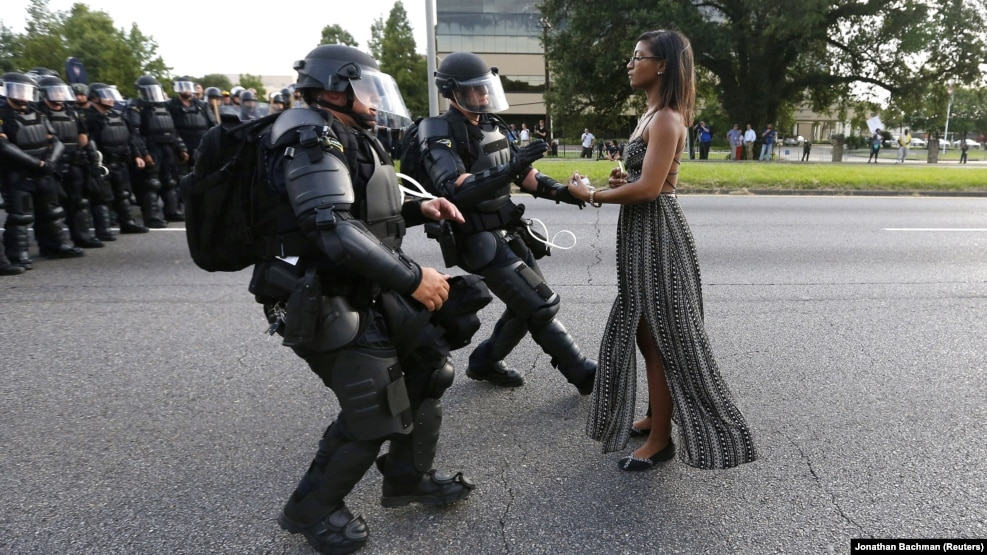 "Ieshia Evans became a symbol of the Black Lives Matter movement in the United States after her arrest during a protest in Baton Rouge. Reuters photographer Jonathan Bachman, who captured the moment, told a colleague that ""I turned and looked over my right shoulder and saw this woman standing in the road. I knew right away what was about to happen. ""I quickly moved and took the shot. When I came back to my car and looked through my take I knew I had a strong image,"" he was quoted as saying by the news agency. ""However, I didn't anticipate that the image would go viral. I am grateful that it has stimulated a discussion about an important issue in this country."""