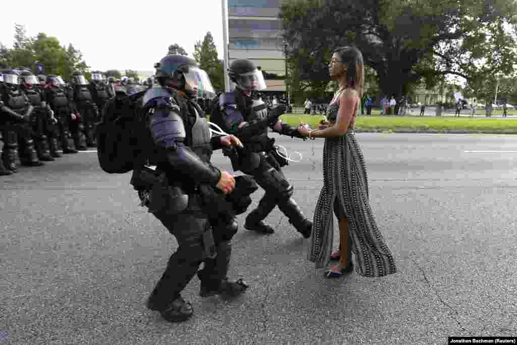 Protestor Ieshia Evans is confronted by law enforcement at a demonstration near the headquarters of the Baton Rouge Police Department, in Baton Rouge, Louisiana, on July 9, 2016. Contemporary Issues -- First Prize, Singles (Jonathan Bachman, Reuters)