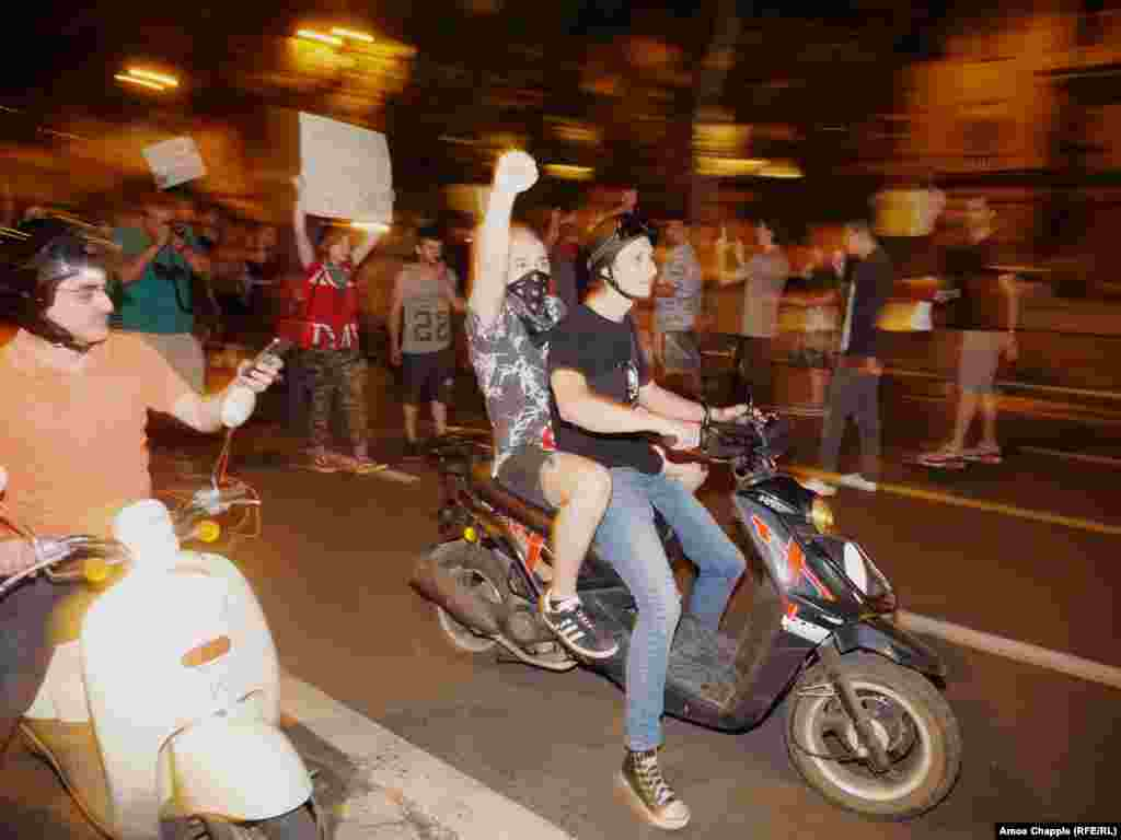A group of young protesters on scooters during the short march.