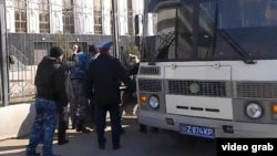 Kazakh police detain protesters against the confiscation of their land by the state in Astana on April 15.