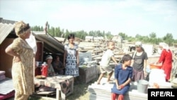 Villagers in Chek on the Kyrgyz-Uzbek border in July