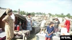 Villagers in Chek on the Kyrgyz-Uzbek border in July