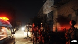Pakistani paramilitary soldiers cordon off the site of an attack on a Karachi market on October 19.