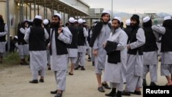 Newly freed Taliban prisoners are seen at Bagram prison, north of Kabul, on April 11.