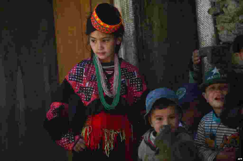 The Kalash are easy to spot. Many wear rings in their hair and sport brightly colored hats. The women sometimes have tattooed faces and wear black robes with colorful embroidery. They speak Kalash, also known as Kalasha, a Dardic language that is a subgroup of the Indo-Aryan languages spoken in northwest Pakistan, in the disputed Himalayan region of Kashmir, and in eastern Afghanistan.