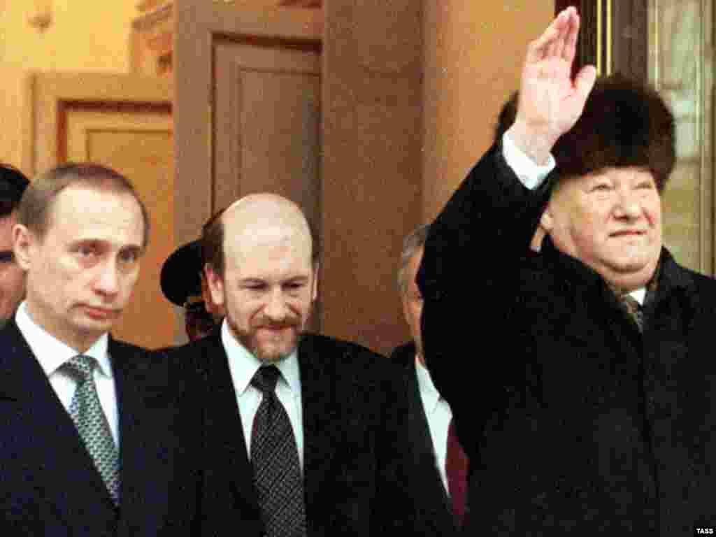 Yeltsin (right) waves as he prepares to hand over the presidential office to Putin (left) at the Kremlin in Moscow on December 31, 1999.