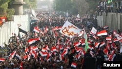 Supporters of Iraqi Shi'ite cleric Muqtada al-Sadr shout slogans during an anti-Turkey protest in front of the Turkish Embassy in Baghdad on October 18.