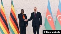 Azerbaijan prezidenti İlham Əliyev (sol) və Zimbabve prezidenti Emmerson Mnangagwa, 19 yanvar 2019