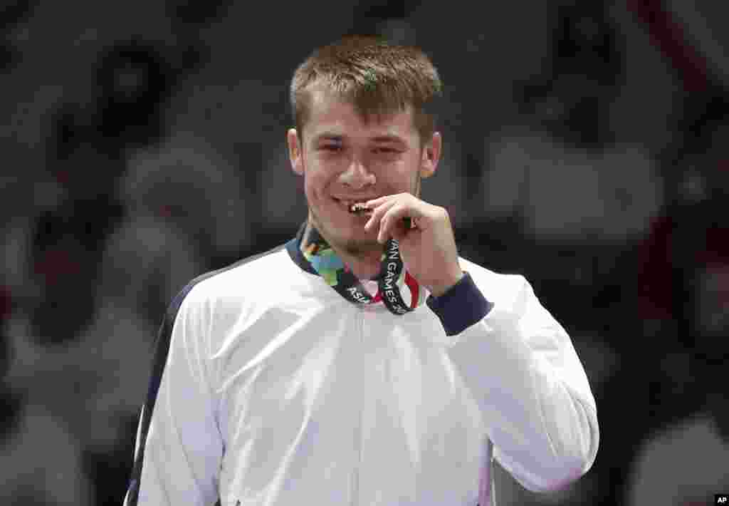 В соревнованиях джитсеров Руслан Исраилов одолел всех своих соперников и стал чемпионом Азиады по джиу-джитсу в весовой категории до 77 килограммов. 26 августа 2018 года.