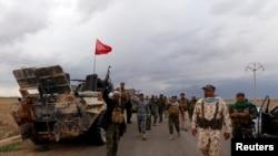 Бойцы шиитского ополчения входят в город Хамрин иракской провинции Салах-эд-Дин. 3 марта 2015 года.