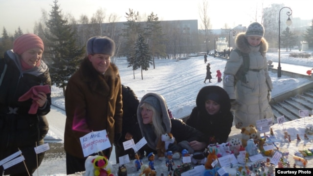 "Protesters use toys to hold a ""nano demonstration"" in the Siberian city of Barnaul."