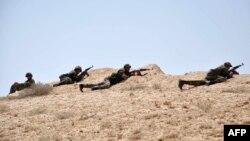 Сирия аскерлери Палмираны коргоп жаткан учур. 17-май, 2015-жыл.