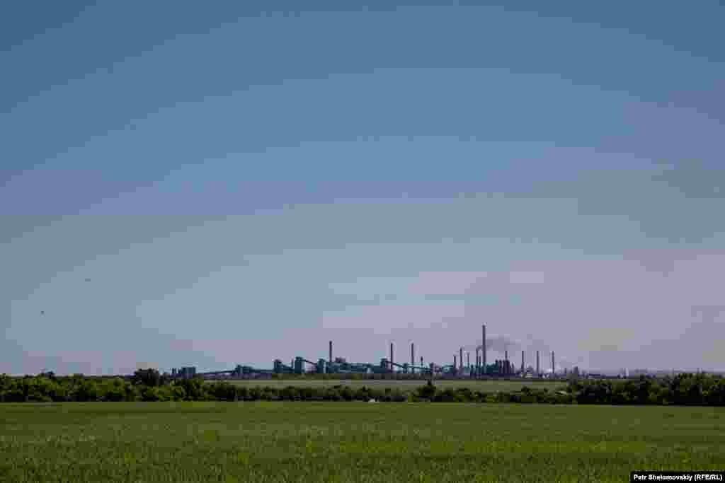 Avdiyivka coke chemical plant as seen from a field near the town on June 9, 2015.