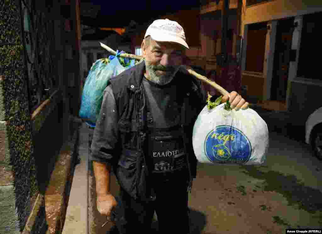 "Michaelis Bupakash, on his way home from the taverna after coffee and a smoke. For the 59-year-old handyman, today's migrants are a reminder of his own ancestors, who fled to Greece from  Anatolia. He says he has no bitterness toward the Afghan migrants who stripped his garden of vegetables, adding, ""They did it because they were hungry."""