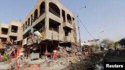 Pamje pas një sulmi të mëparshëm në një lagje të kryeqytetit Bagdad në Irak