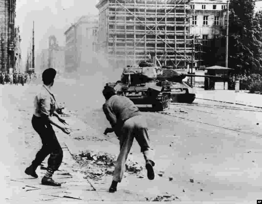 Germans throwing rocks against Soviet T-34 tanks on Leipziger Strasse, EastBerlin,June 17, 1953.