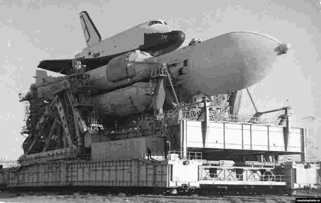 The U.S.S.R.'s Buran spaceplane being moved toward its launchpad in 1988. The craft had its maiden launch that year, successfully orbiting the Earth without a crew before being permanently grounded due to the fall of the Soviet Union. In 2002, Buran's storage hangar collapsed during a storm, killing eight workers and destroying the shuttle.