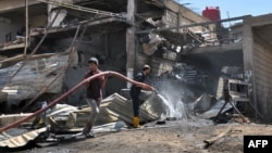 The aftermath of a suicide bomb attack targeting Kurdish security forces in Qamishli in Syria's northeastern Hasakeh Province in August