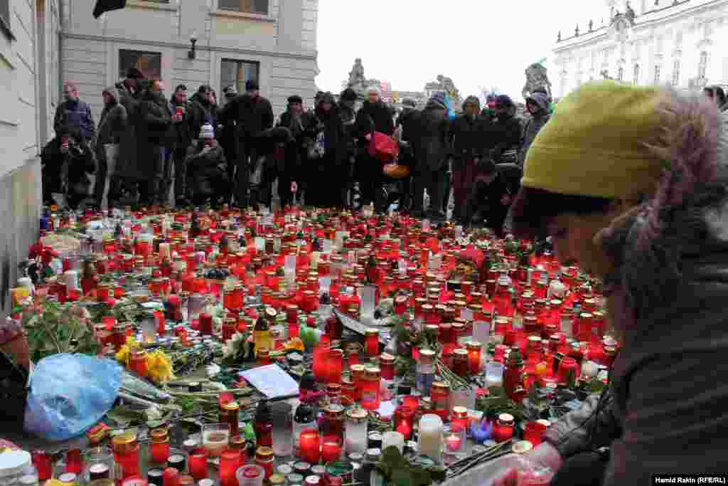 Mourners place candles outside Prague Castle as they await the arrival of the hearse carrying the late Czech President Vaclav Havel.