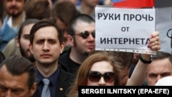 "A woman holds a banner reading ""Hands off the Internet"" during a rally in Moscow in April."