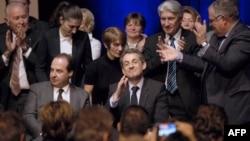 Екс-президент Франції Ніколя Саркозі (справа) і лідер правоцентристської партії UDI Жан-Крістоф Лагард (зліва)