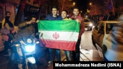 Tehran residents celebrate news of the potential nuclear agreement between Iran and world powers on April 2.