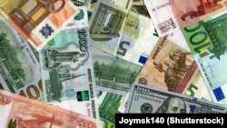 Generic - Photo ©Shutterstock, Russian banknotes (Rubles), US dollars and European currency (Euro) background, undated