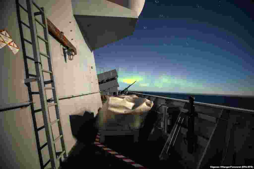 Northern lights are seen from the KNM Helge Ingstad during the NATO-led Trident Juncture exercises in Norway on October 30. (EPA-EFE/Marius Vagenes Villanger/Forsvaret)