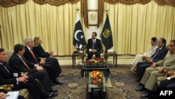 Pakistani Prime Minister Yousuf Raza Gilani (center), U.S. Secretary of State Hillary Clinton (top left), Pakistani army chief General Ashfaq Kayani (right) and CIA chief David Petraeus (left) meeting in Islamabad on October 20.