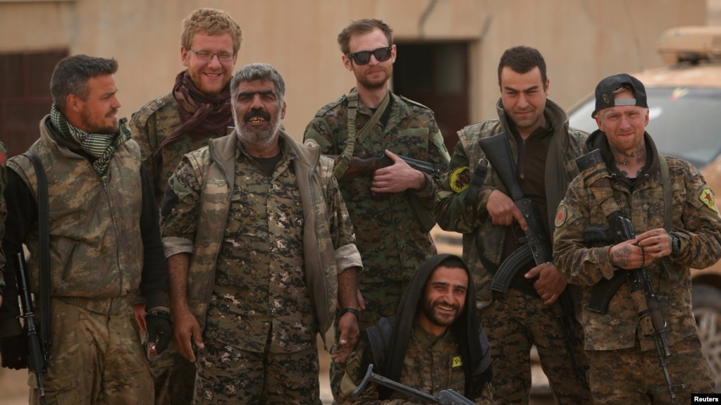 Syrian Democratic Forces (SDF) fighters pose near Raqqa (file photo).