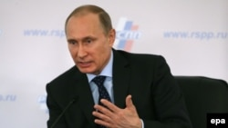 Russian President Vladimir Putin speaks during a business conference in Moscow on March 20
