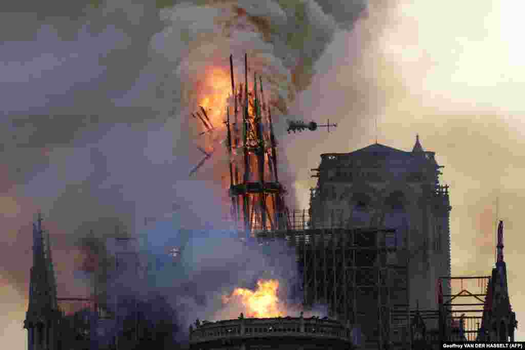 The spire collapses in flames during the blaze on April 15, 2019.