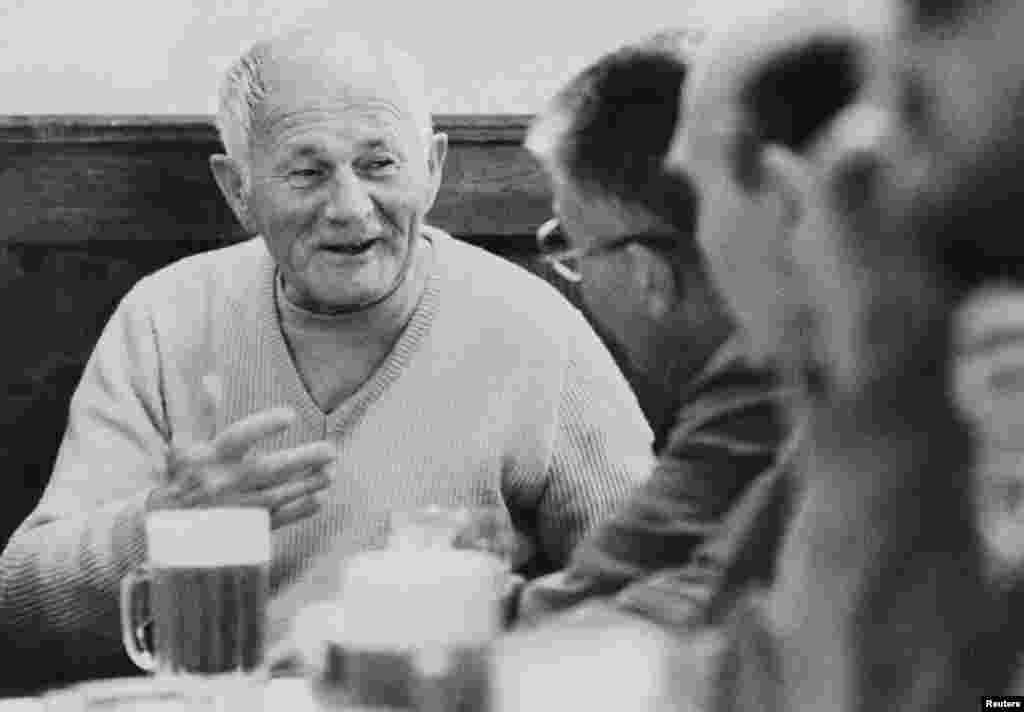 Known as a great raconteur, Bohumil Hrabal talks to friends at his favorite Prague pub, U Zlateho Tygra (At the Golden Tiger), where he was a regular fixture.