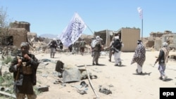 Suspected Taliban militants patrol after they reportedly took control of a rural district in Afghanistan's central Ghazni's province in May.