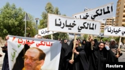 Сторонники аль-Малики на демонстрации в Багдаде 13 августа 2014 года