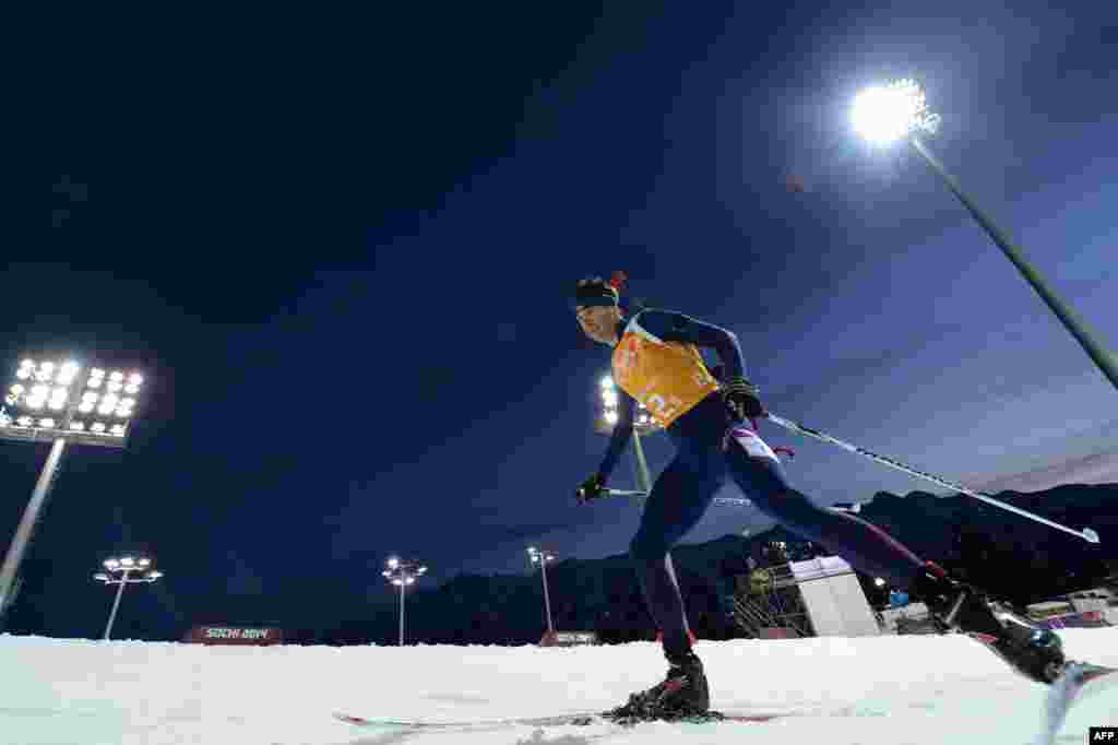Norway's Ole Einar Bjoerndalen competes in the mixed biathlon relay. Norway won gold. (AFP/Kirill Kudryavtsev)