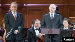 Valery Gergiyev (left), artistic director of the Mariinsky Theater, and Russian leader Vladimir Putin open the International Tchaikovsky Competition in Moscow in June 2011.