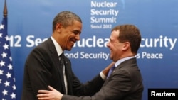 U.S. President Barack Obama (left) greets his Russian counterpart Dmitry Medvedev at a bilateral meeting before attending the 2012 Nuclear Security Summit in Seoul.